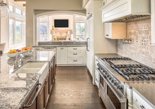 Beautiful Kitchen in New Luxury Home royalty free stock photography