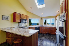 Beautiful kitchen room with skylight granite tile floor stock images