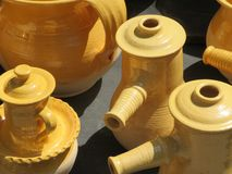 Beautiful kitchen utensils made of clay by hand by expert hands stock image
