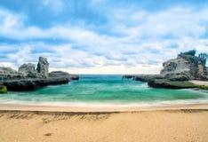 Beautiful klayar beach, east java, indonesia blue water sea stone. Beautiful klayar beach, east java, indonesia blue sea background nature photographysea stone stock image