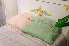 Beautiful knitted Pillow on sofa at home Royalty Free Stock Photography