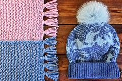 Beautiful knitted scarf and hat with fur pompon Royalty Free Stock Photography