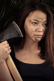 Beautiful Korean girl with ax in hands. Closeup Royalty Free Stock Photos