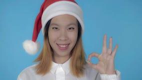 Beautiful korean girl christmas showing gesture ok stock photo
