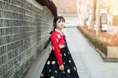 Beautiful Korean girl in Hanbok at Gyeongbokgung, the traditional Korean dress.  Royalty Free Stock Photos
