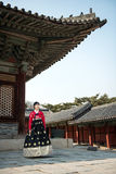 Beautiful Korean girl in Hanbok at Gyeongbokgung, the traditional Korean dress.  Stock Images