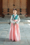 Beautiful Korean girl in Hanbok at Gyeongbokgung, the traditional Korean dress.  Stock Photo
