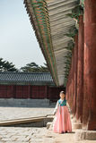 Beautiful Korean girl in Hanbok at Gyeongbokgung, the traditional Korean dress.  Royalty Free Stock Image