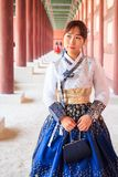 Beautiful Korean woman dressed Hanbok in Gyeongbokgung Palace in Seoul. Beautiful Korean woman dressed Hanbok, Korean traditional dress, in Gyeongbokgung Palace stock photography