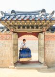 Beautiful Korean woman dressed Hanbok, Korean traditional dress, in Gyeongbokgung Palace Stock Photos