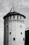 Beautiful Kremlin tower in Kolomna, Russia. Old beautiful Kremlin tower made of bricks, with many windows and a round wooden roof. Black and white photo. Cremlin Stock Photos