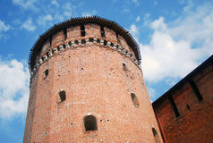 Beautiful Kremlin tower and wall, Kolomna, Russia. Old beautiful Kremlin tower made of red bricks, with many windows and a round wooden roof, Cremlin defence Royalty Free Stock Photo