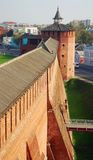 Beautiful Kremlin tower and wall, Kolomna, Russia. Old beautiful Kremlin tower made of red bricks, with many windows and a round wooden roof, Cremlin defence Stock Photo