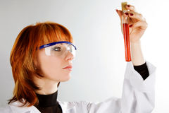 Beautiful laboratory technician with tube of blood Stock Photo