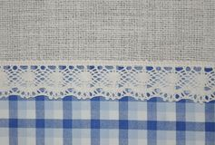 Beautiful lace and blue tartan textile texture background. Lacy lace ribbon flax backdrop Stock Photo