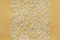 Beautiful lace on paper Royalty Free Stock Image