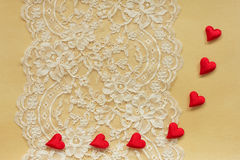 Beautiful lace on  paper with red hearts Stock Photo