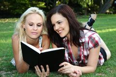 Beautiful Ladies Reading Book Royalty Free Stock Image