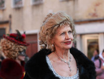 Beautiful lady. Venice,Italy- February 26th, 2011: Enviromental portrait of a beautiful old lady participating in a costumes parade on Sestiere Castello during Royalty Free Stock Images
