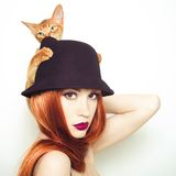Beautiful lady with Abyssinian cat. Fashion photo of elegant lady with Abyssinian cat royalty free stock photography