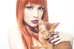 Beautiful lady with Abyssinian cat. Fashionable photo of elegant lady with Abyssinian cat stock photography