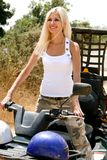 Beautiful lady on all terrain vehicle Royalty Free Stock Photos