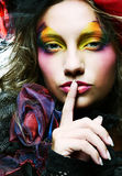 Beautiful lady  with artistic make-up. Stock Photography