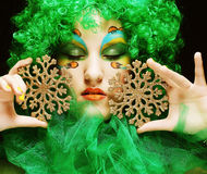 Beautiful lady with artistic make-up Stock Image