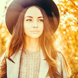 Beautiful lady in autumn landscape Stock Images