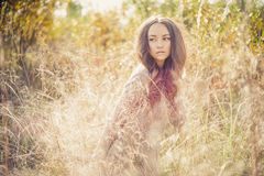 Beautiful lady in autumn landscape Royalty Free Stock Photos