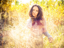 Beautiful lady in autumn landscape Royalty Free Stock Photo