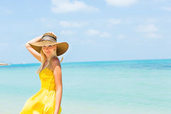 Beautiful lady on the beach Stock Image