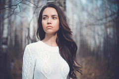 Beautiful lady in a birch forest. Outdoor fashion photo of young beautiful lady in a birch forest Stock Photo