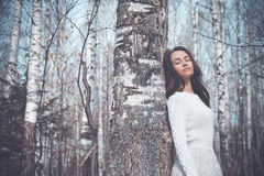 Beautiful lady in a birch forest Royalty Free Stock Images