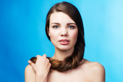 Beautiful lady on blue background Royalty Free Stock Images