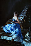 Beautiful lady in blue dress Stock Photography
