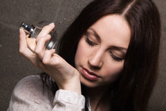 Beautiful lady with a bottle of perfume Royalty Free Stock Photography