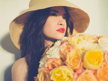 Beautiful lady with bouquet of roses Stock Image