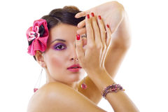 Beautiful lady with bright purple make-up Stock Photography