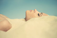 Beautiful Lady Buried In The Sand Stock Photo