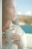 Beautiful lady with cap of coffee Stock Images