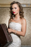Beautiful lady with case Stock Images