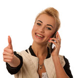 Beautiful lady with cell phone talking isolated over white Stock Photography