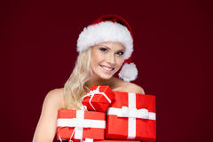 Beautiful lady in Christmas cap Royalty Free Stock Photography