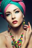 Beautiful lady with colored turban. Beautiful lady with multi-colored turban and necklace Stock Photo