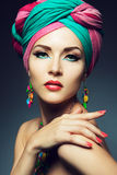 Beautiful lady with colored turban Stock Photos