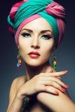 Beautiful lady with colored turban. Beautiful lady with multi-colored turban and necklace Stock Photos