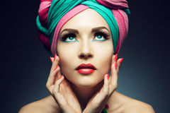 Beautiful lady with colored turban. Beautiful lady with multi-colored turban and necklace Royalty Free Stock Photos