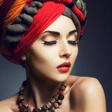 Beautiful lady with colored turban. Beautiful lady with multi-colored turban and necklace Royalty Free Stock Photo