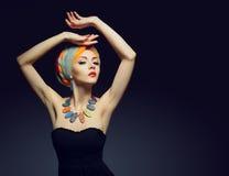 Beautiful lady with colored turban. Beautiful lady with multi-colored turban and necklace Royalty Free Stock Photos